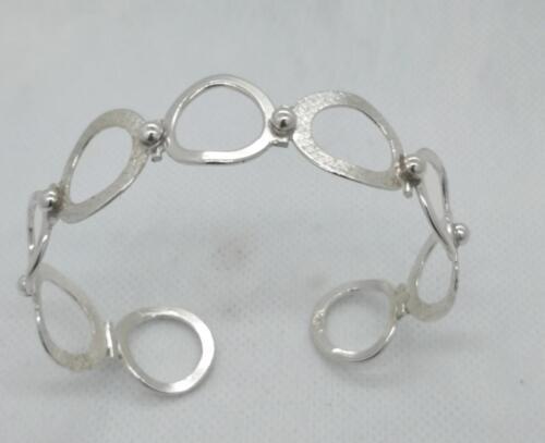 """""""Munkar"""" Öppet armband med ringar i silver. 1250:- SEK"""